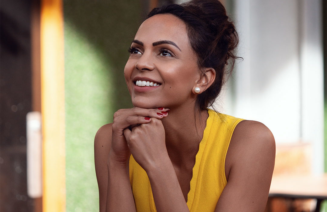portrait of woman smiling wearing yellow dress by amy rose hancock